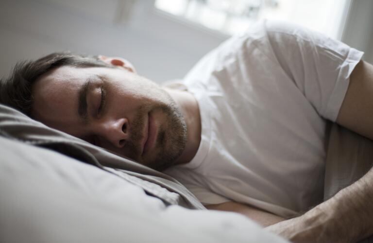man-sleeping-on-side