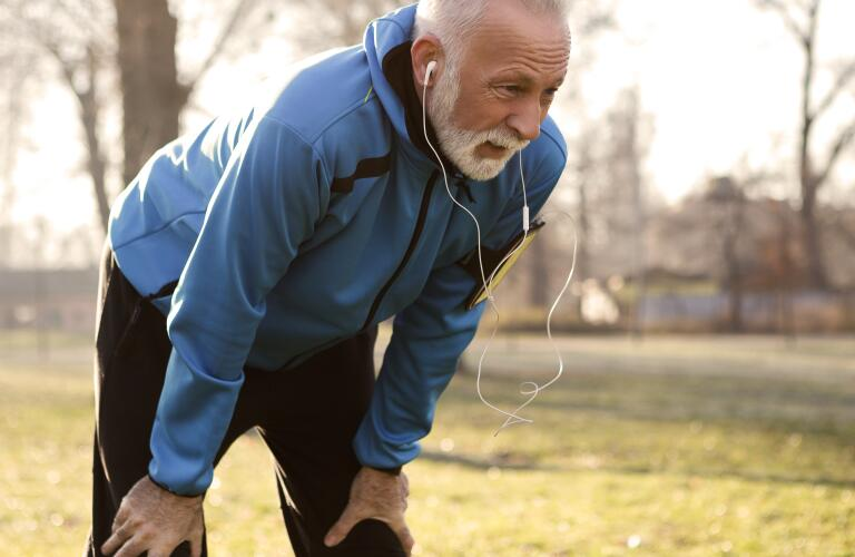 Older man out of breath while running