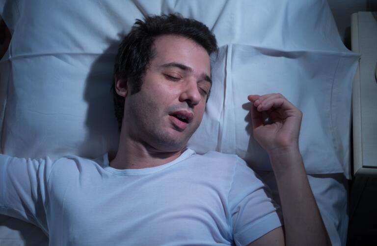 man sleeping with mouth open