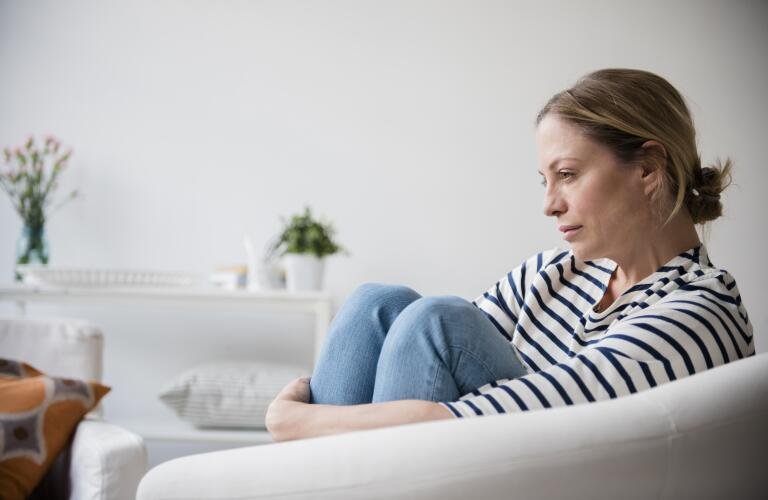 concerned woman sitting in chair
