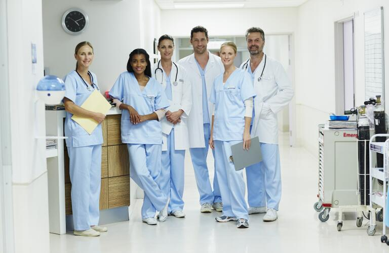 group-of-healthcare-workings-standing-in-hospital
